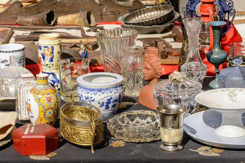 Jumble of knick-knack and trinkets on sale at street market, Ch. Jumble of vintage trinkets and knick-knacks on sale in bric-a-brac antiques street market, shot royalty free stock photography