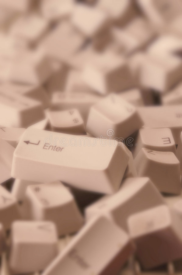Jumbled Computer Keys. A jumbled pile of computer keys with the Enter key on top stock image
