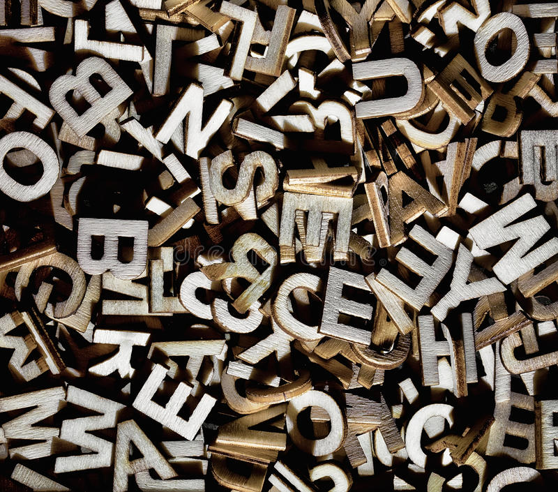 Jumbled letters made of wood. Close up stock images