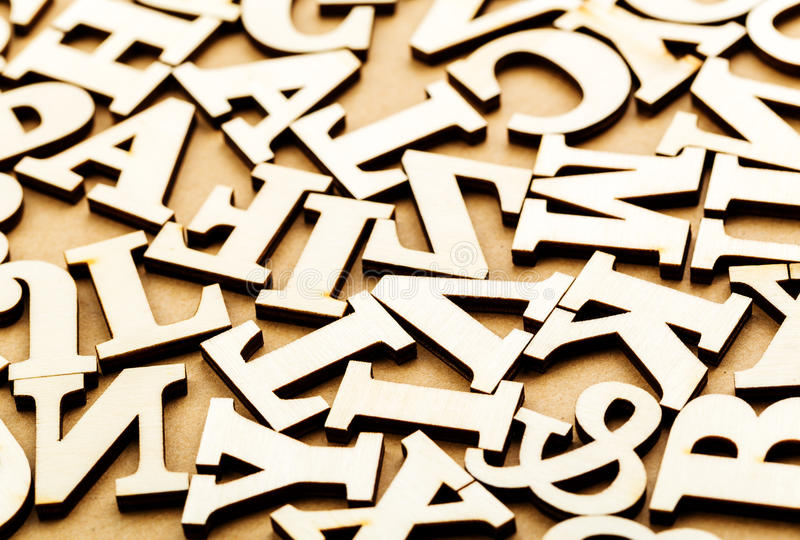 Jumbled wooden letter. Over brown background stock photography