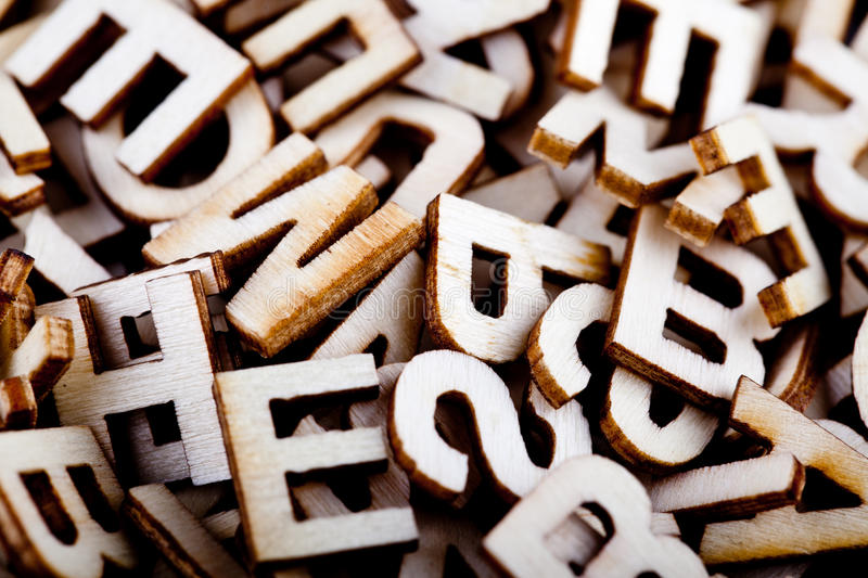 Jumbled wooden letters close up. In a pile royalty free stock photography