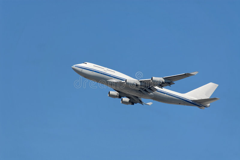 Jumbo jet. Ascending after takeoff stock photography