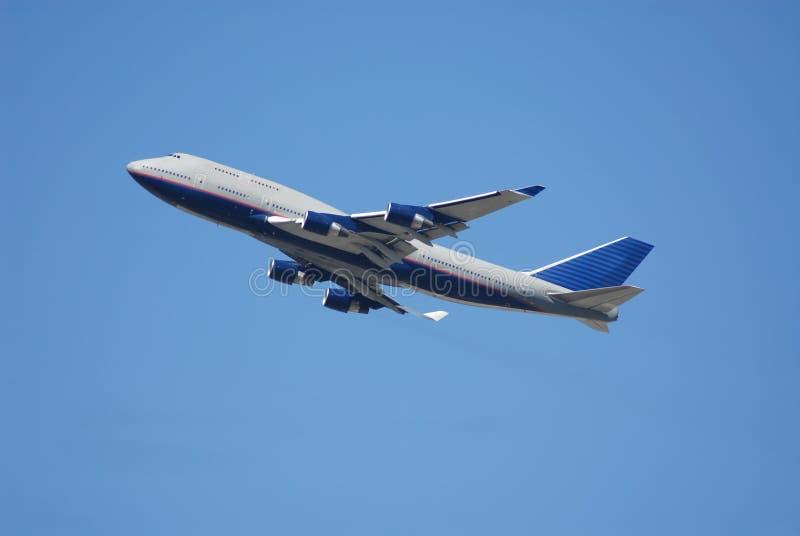 Jumbo jet. Shortly after takeoff royalty free stock photo
