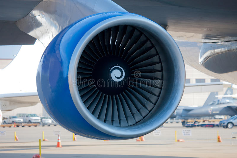 Jumbo Jet Engine Closeup. With Airplane parked in airport royalty free stock photos