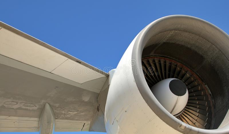 Jumbo Jet Engine & Wing. Vivid image of a jumbo jet engine and wing set against a perfect blue sky royalty free stock photos