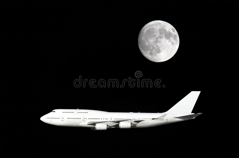 Jumbo jet under full moon stock photo