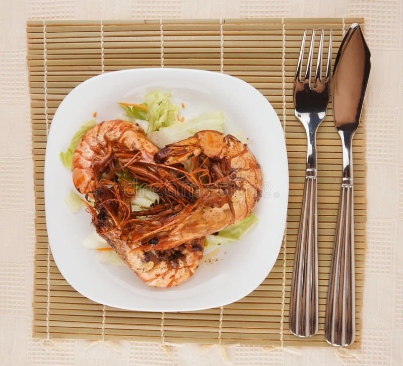 Jumbo Prawns And Grilled Squids With Black Rice Isolated