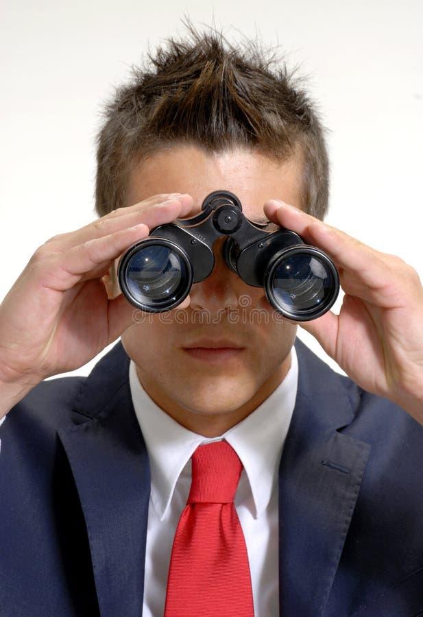 Jumelles d'homme d'affaires. photographie stock