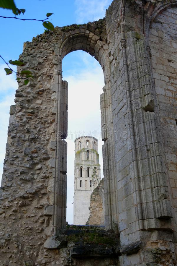 View trough the window in the ruined wall of gothic church royalty free stock photography