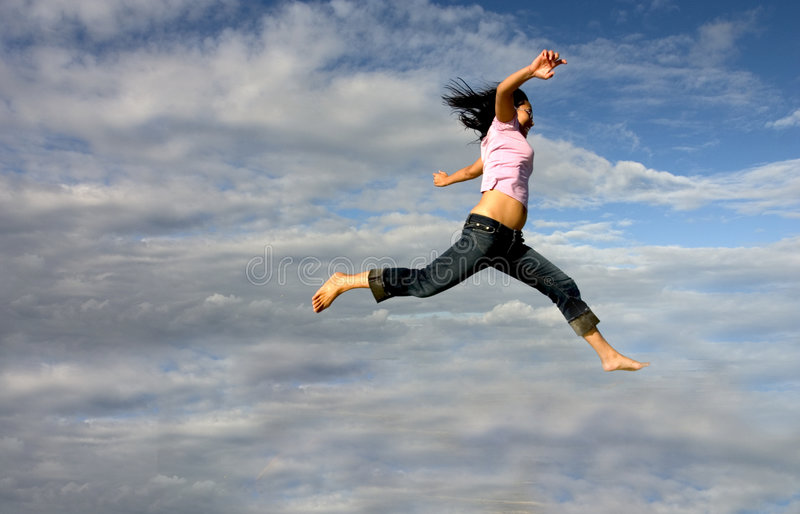 Jump!. Woman Jumping shot with 300D and 17-40mm royalty free stock image