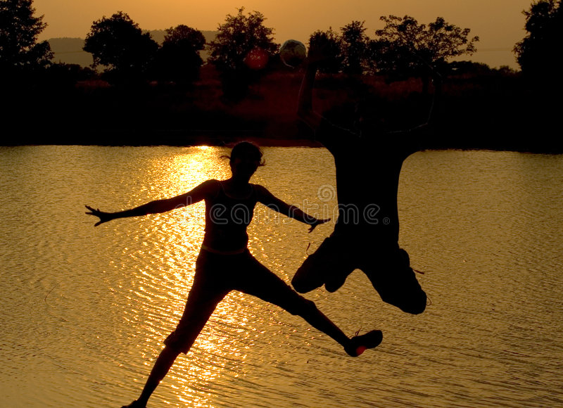 Download Jump! stock photo. Image of sunset, lake, freak, teamwork - 46076