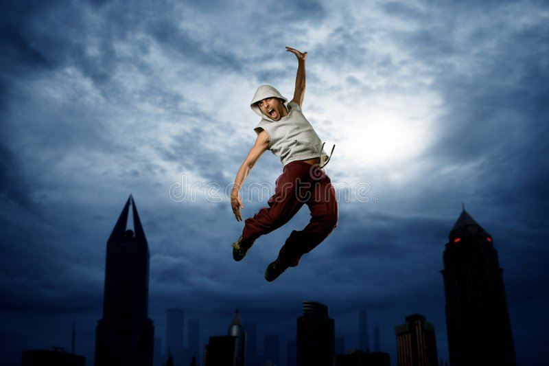 Jump. A young rapper jump in the city stock image
