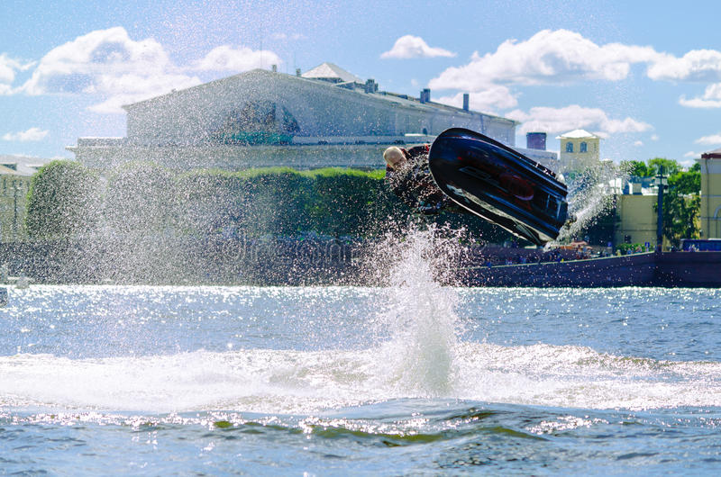 Jump athlete surfer. Jump athlete surfer on the background of the Neva river in St. Petersburg stock photo