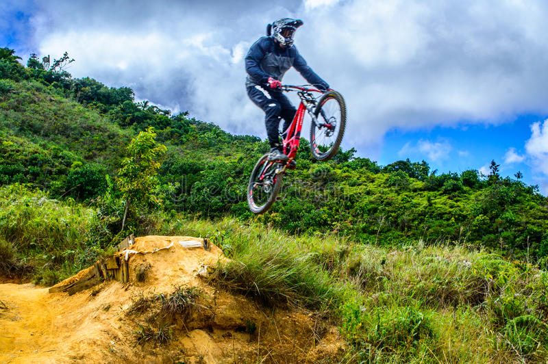 Jump. A biker taking a jump in a dirt road on The Volcano mountain in Caracas, Venezuela royalty free stock photography