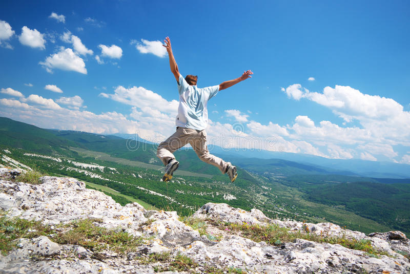 Jump from the cliff stock photography