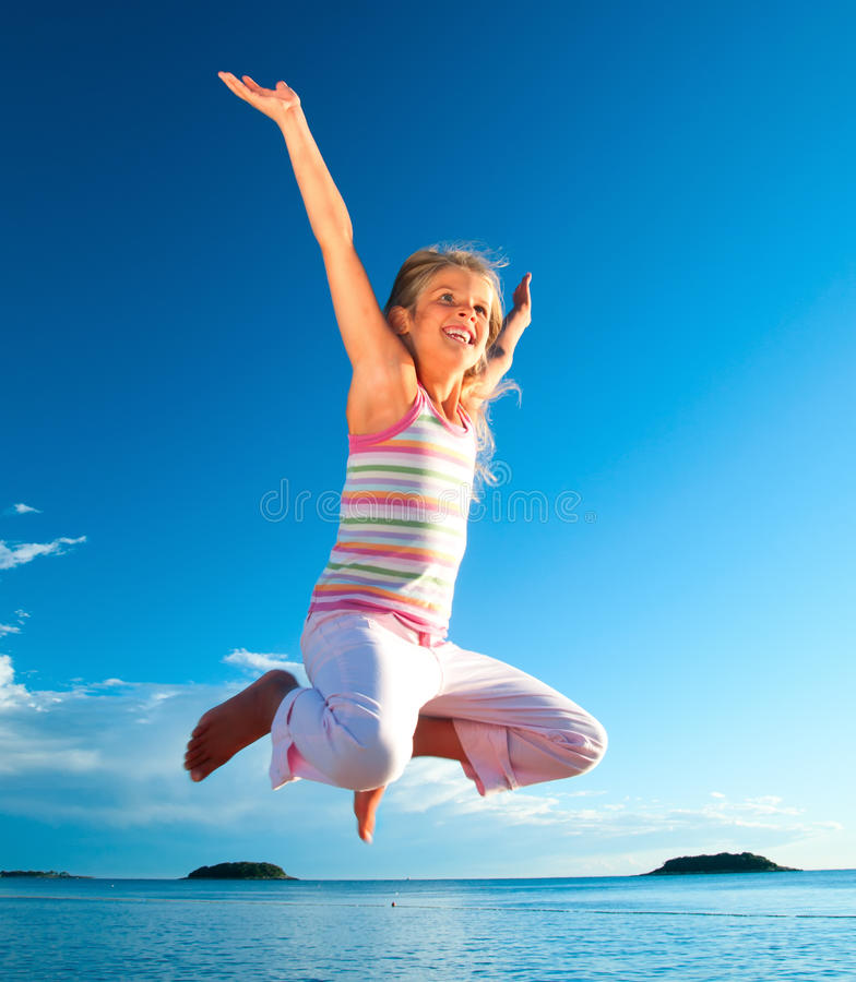 Jump Girl And Sea stock photo