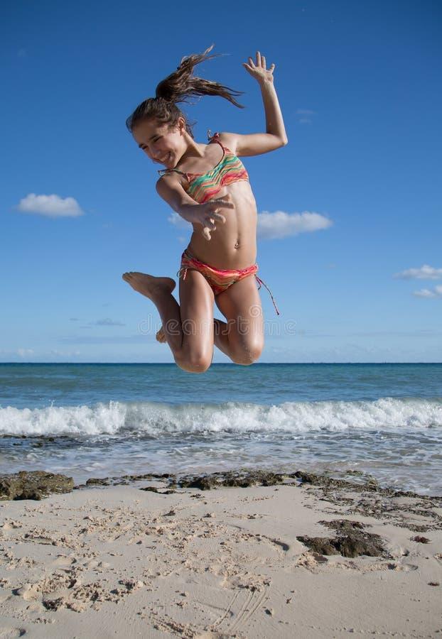 Jump of joy on the beach royalty free stock photo