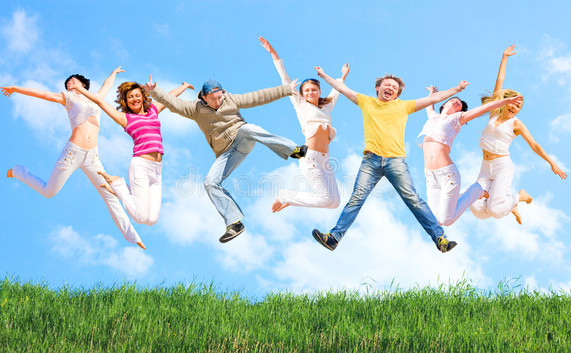 Jump Of A Group Of People Stock Photo
