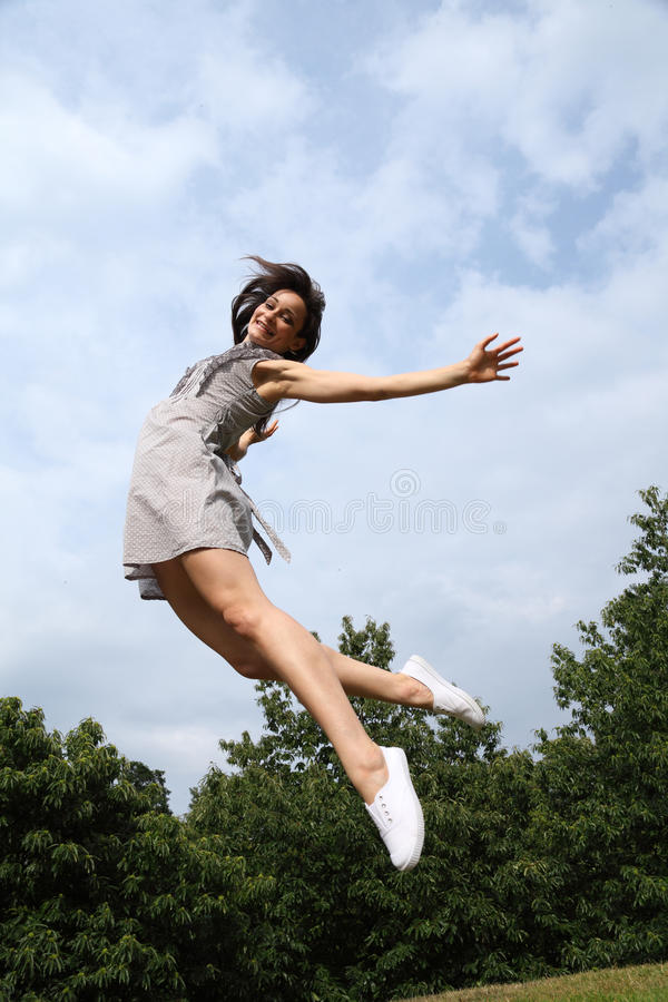 Jump for happy success by beautiful woman royalty free stock images