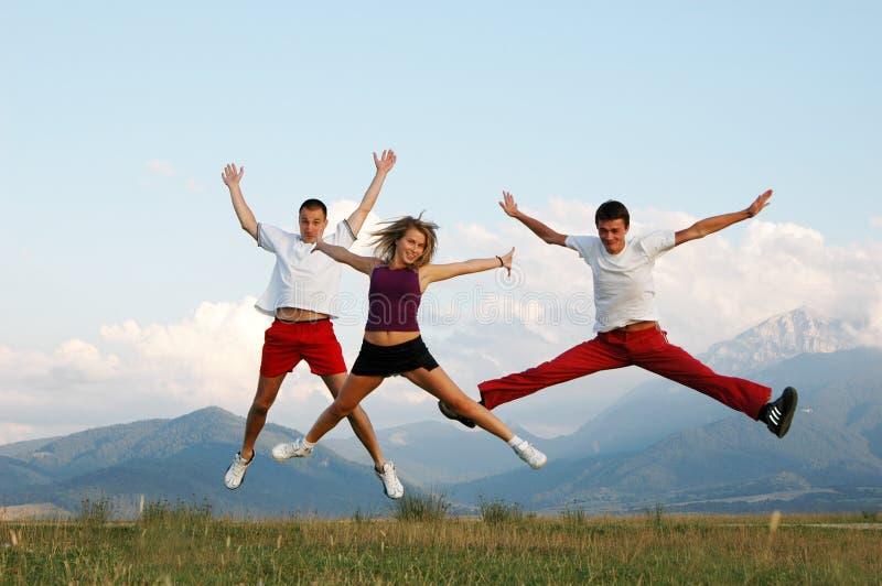 Jump for joy. Three people jump for joy