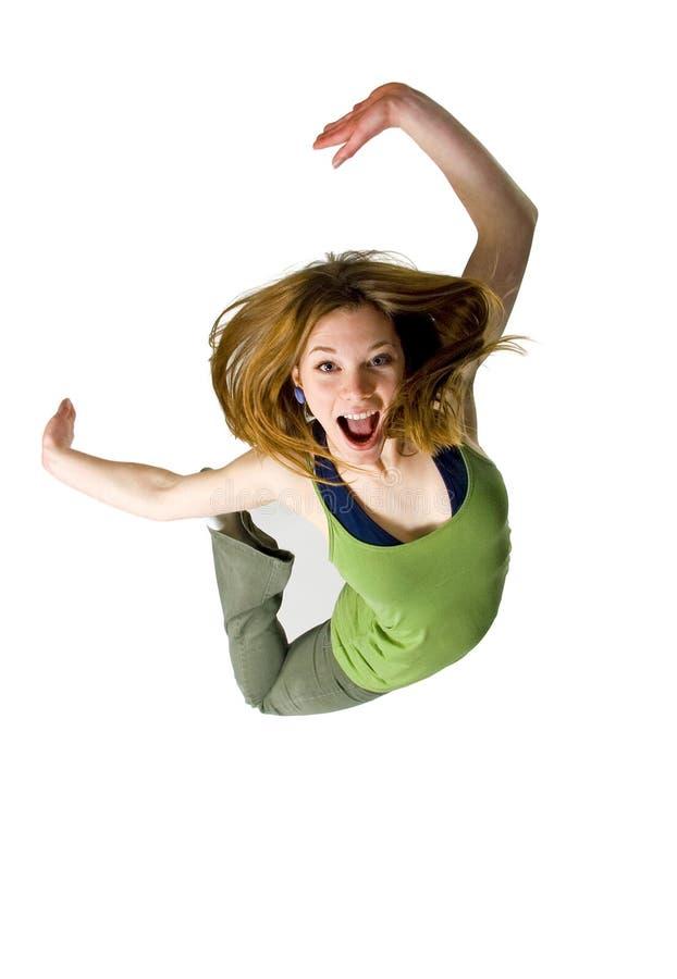 Jump for joy. Teen girl jumping for joy on white background stock image