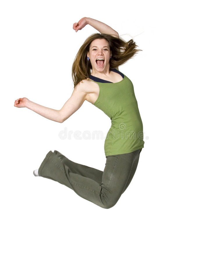 Jump for joy. Teen girl jumping for joy on white background stock photography