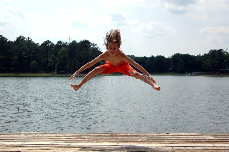 Download Jump at lake stock photo. Image of high, people, kids, vacation - 899714