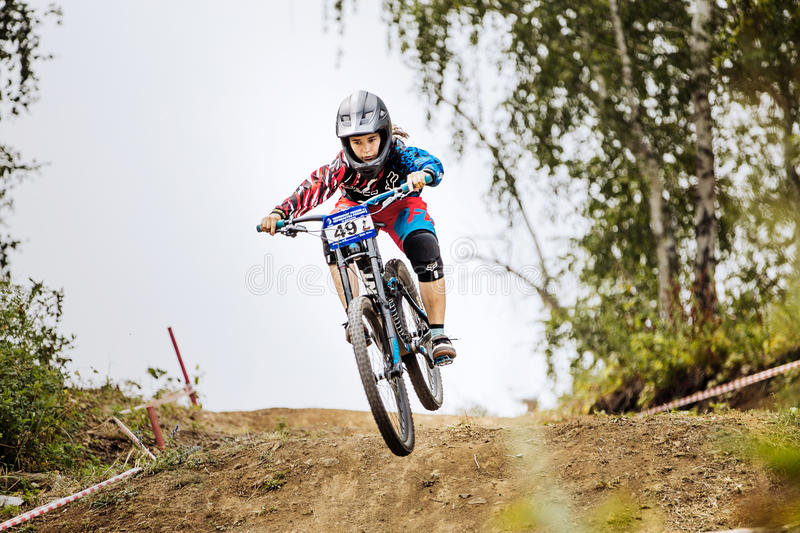 Jump over mountain girls extreme athlete bike. Magnitogorsk, Russia - July 23, 2016: jump over mountain girls extreme athlete bike during National championship royalty free stock images