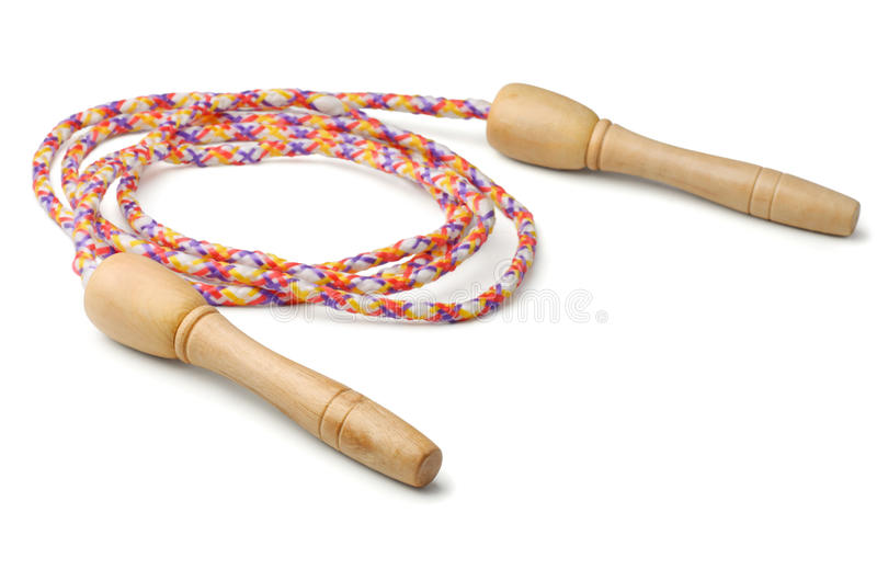 Jump rope. With wooden handles on white royalty free stock photo
