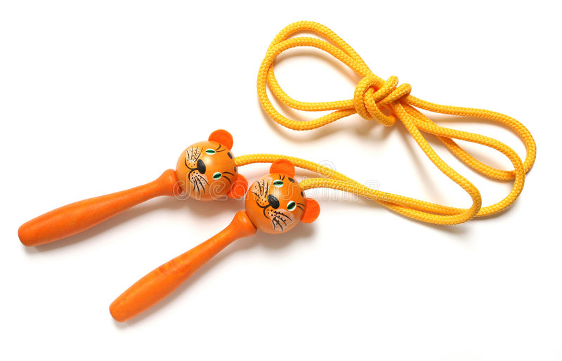 Jump rope. Orange jump rope isolated on white background stock images