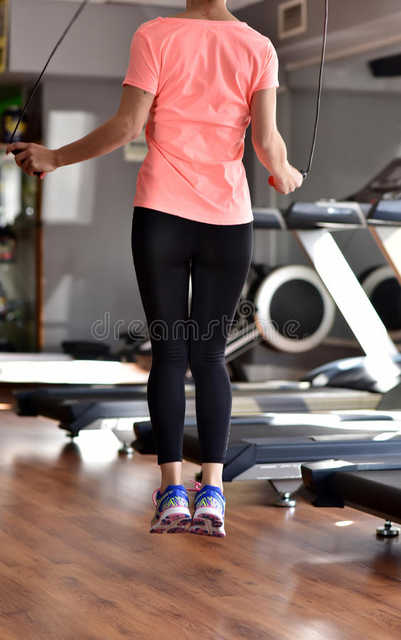Jump Rope exercice. Jump Rope Workout at the fitness center royalty free stock photos