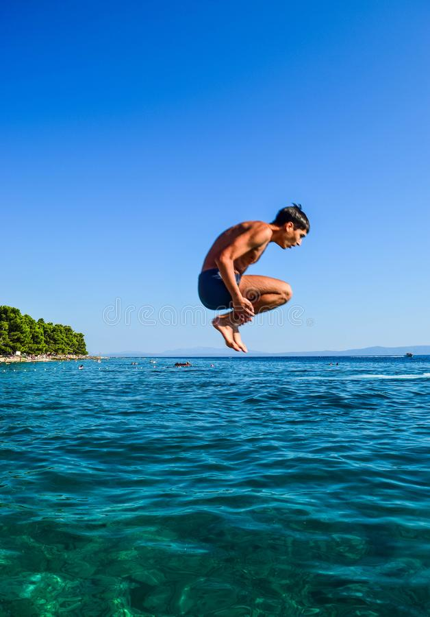 Jump into the sea royalty free stock photos