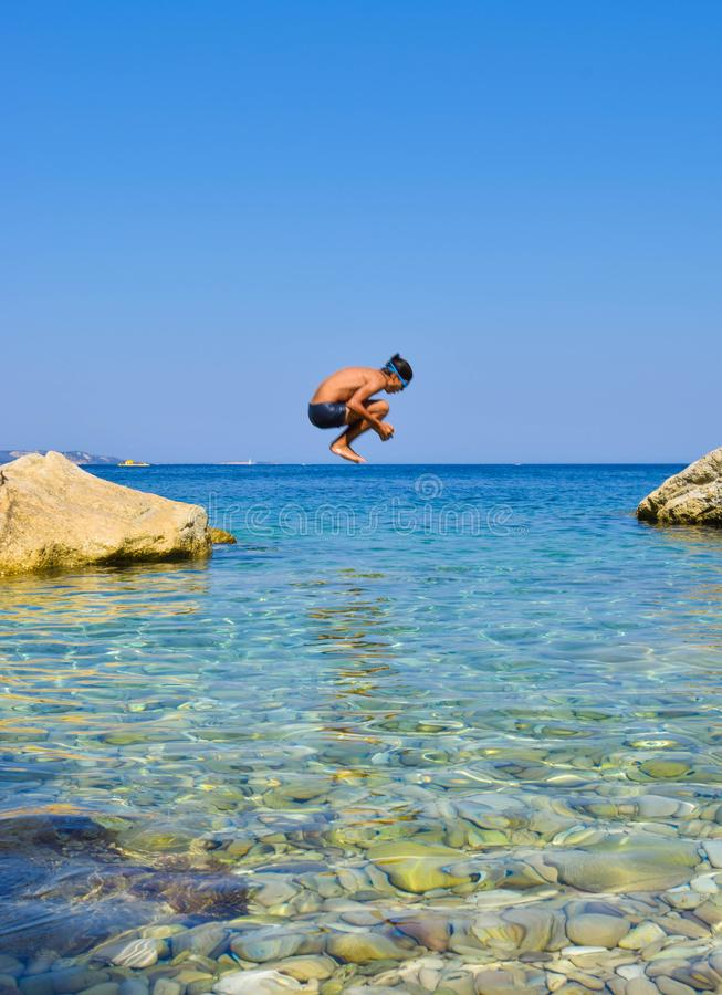 Jump into the sea. royalty free stock photography