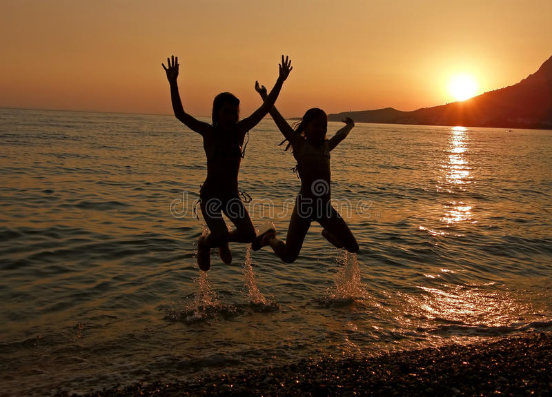 Jump in sea sunset royalty free stock photo