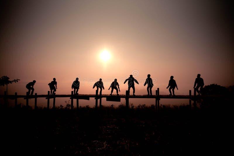 Jump Sunset Silhouette stock image