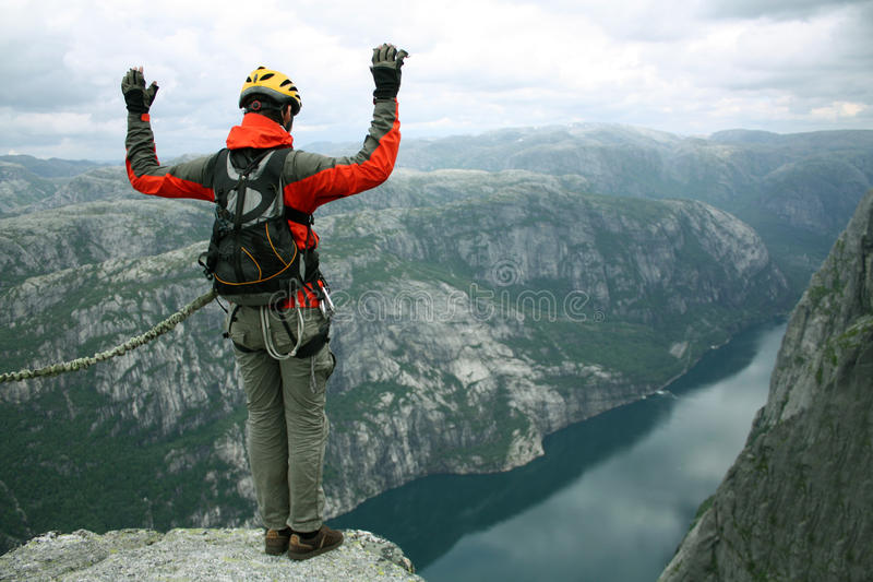 Jump to rope. BASE jump off a cliff stock photos
