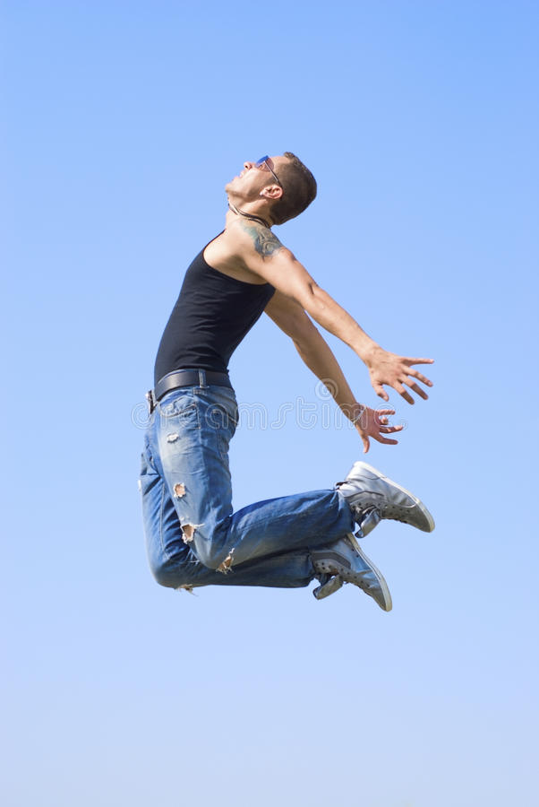 Jump to touch the sky stock image