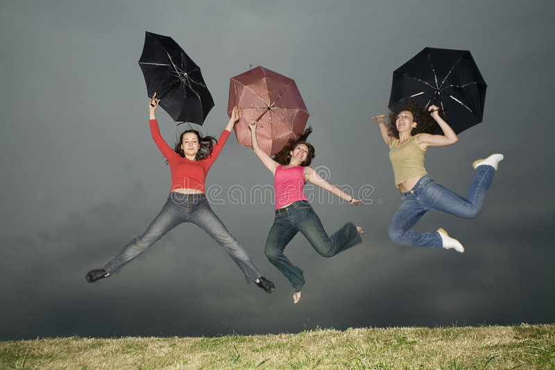 Jump under storm-cloud royalty free stock photography