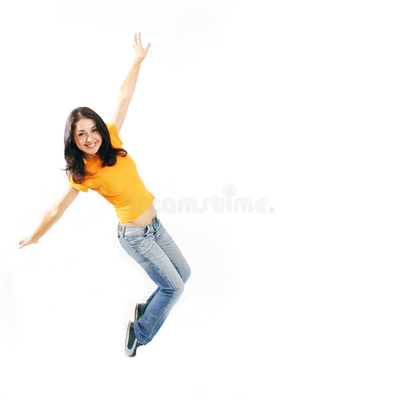 Jump up. Teenager jumping and smiling happily