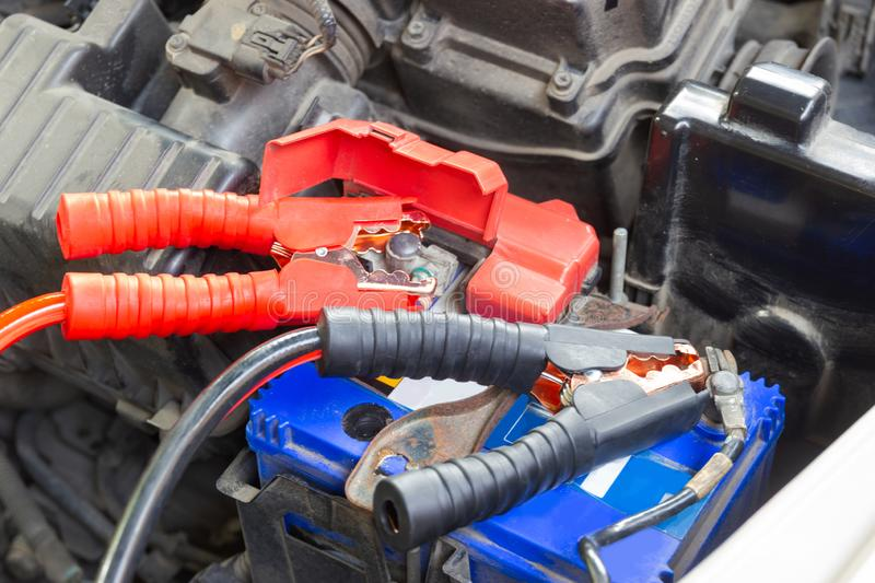Jumper cables for charging vehicle battery Identify the positive and negative terminals. Essentials to Keep in Your Car royalty free stock photography