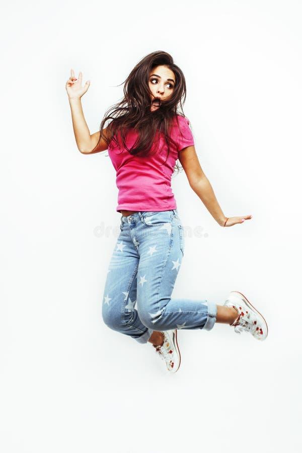 Jumpin emocional de sorriso feliz novo do adolescente latino-americano imagens de stock royalty free