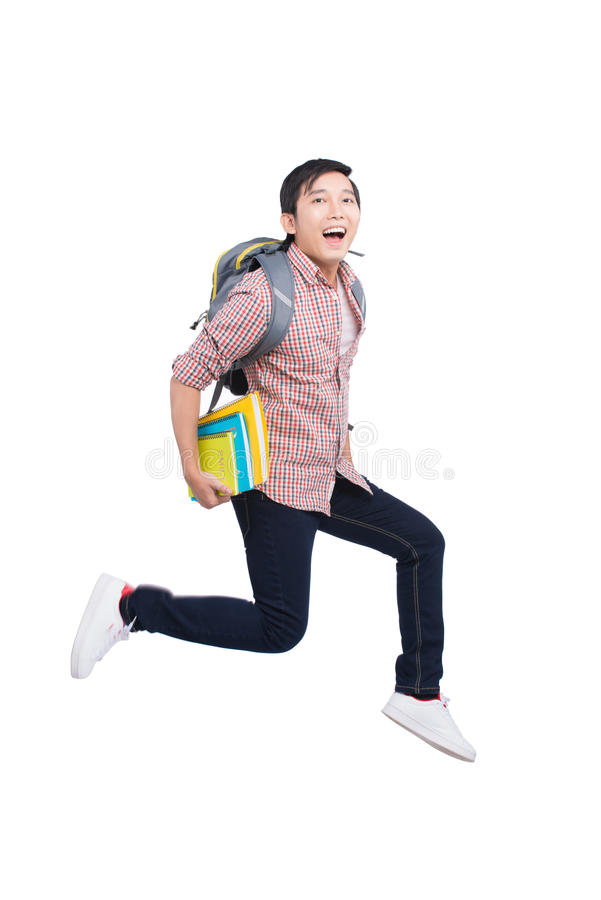 Jumping asian man happy excited on white background. royalty free stock image