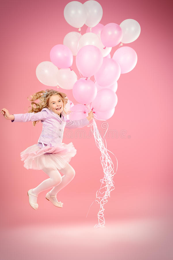 Jumping with balloons stock photography