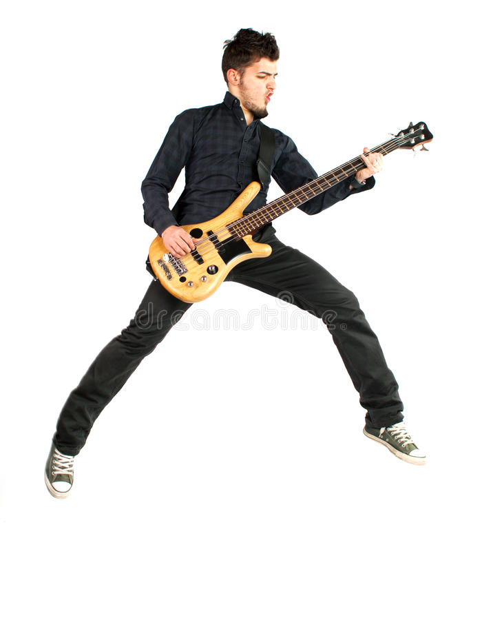 Jumping bass player on a white background stock image