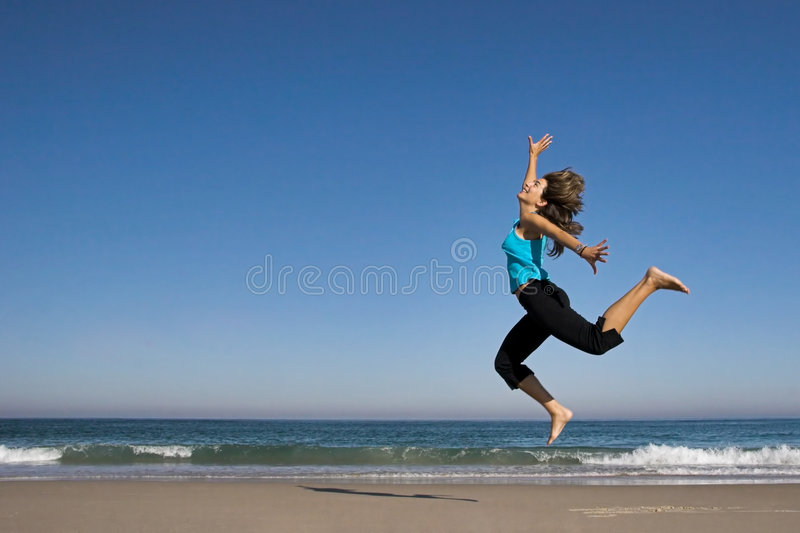 Download Jumping On The Beach Royalty Free Stock Image - Image: 1413306