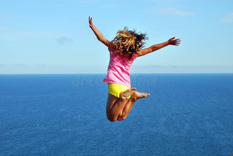 Jumping on the beach royalty free stock photos