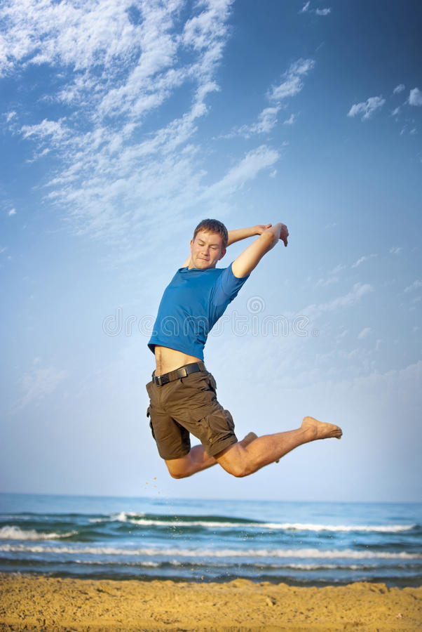 Download Jumping boy sea stock image. Image of athlete, blue, healthy - 17954197