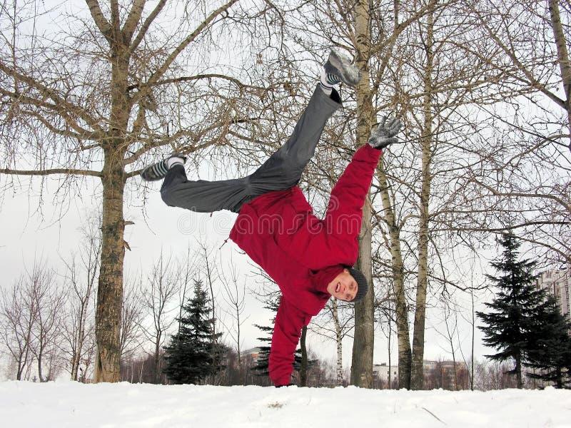 Jumping boy. winter. stock photos