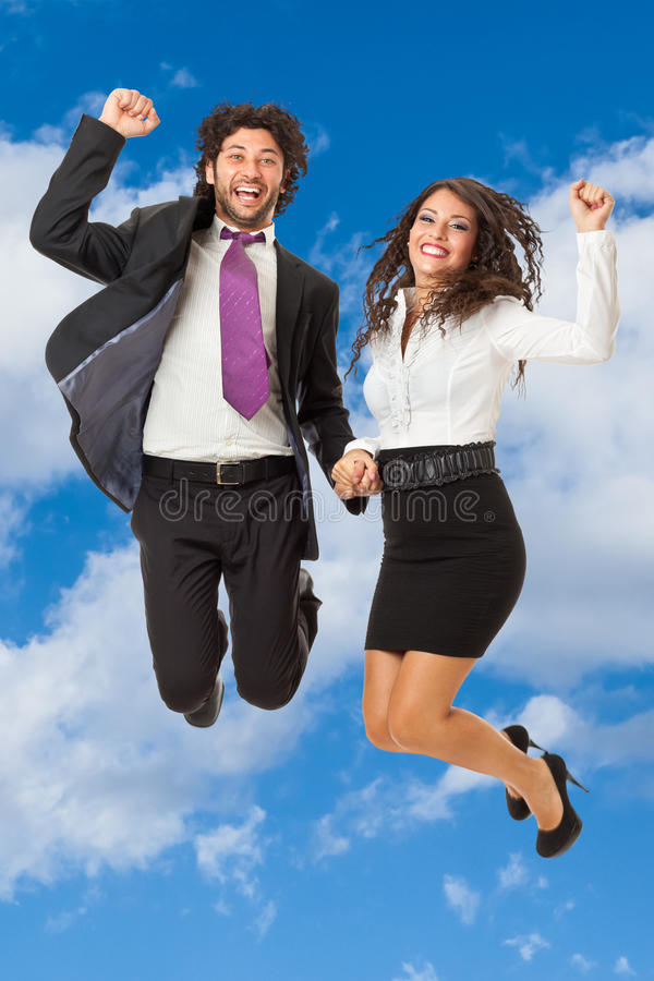 Jumping business couple stock photo