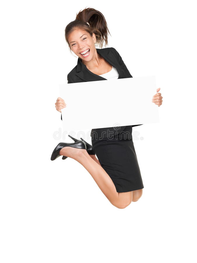 Jumping business happy woman holding white sign stock photography